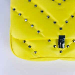 matelassè bag in faux leather with studs