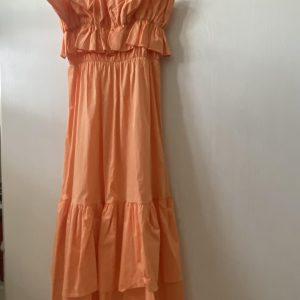 Long orange dress with flounces